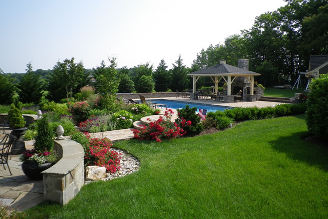 grass and patio space with a large pool in northern virginia